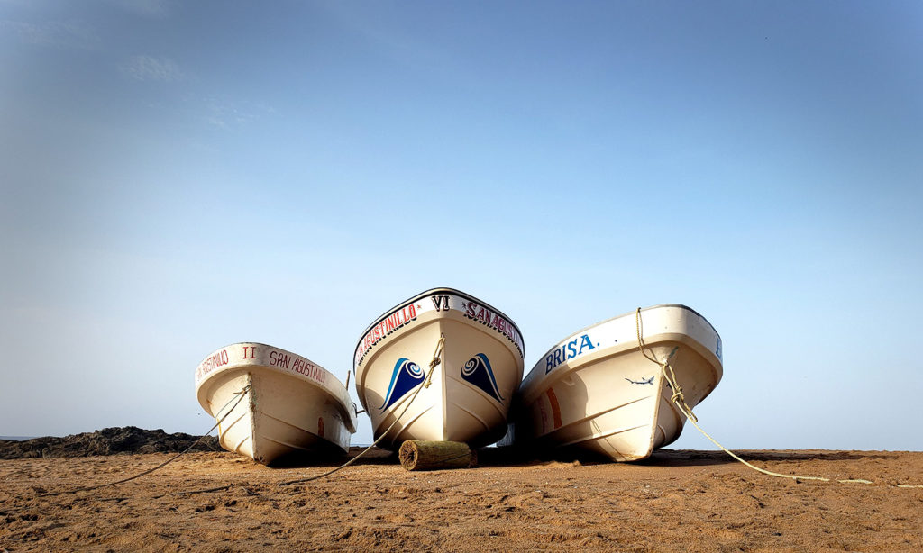 Boats in San Agustinillo, Oaxaca | Humanitou Poetry